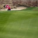 Tommy Fleetwood of England hits from a bunker on 14th hole during the first round of the BMW Masters golf tournament at the Lake Malaren Golf Club in Shanghai, China Thursday Oct.30, 2014. (AP Photo)