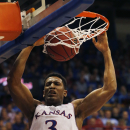 Kansas guard Andrew White III (3) during the first half of an exhibition NCAA college basketball game against Pittsburg State in Lawrence, Kan., Tuesday, Oct. 29, 2013. (AP Photo/Orlin Wagner)