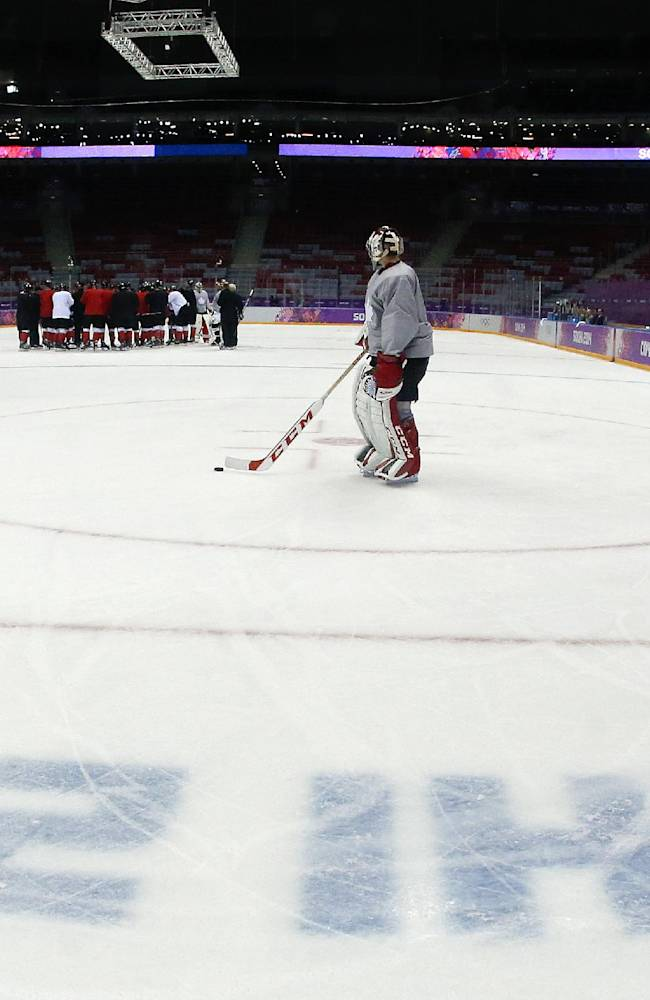 Canada goaltender Roberto Luongo skates out to the net during a training session at the Bolshoy Ice Dome at the the 2014 Winter Olympics, Tuesday, Feb. 11, 2014, in Sochi, Russia