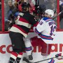 Ottawa Senators defenseman Marc Methot, left, collides with New York Rangers center Derick Brassard during the first period of an NHL hockey game Thursday, March 26, 2015, in Ottawa, Ontario. (AP Photo/The Canadian Press, Adrian Wyld)