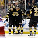 Boston Bruins right wing Reilly Smith, center, is congratulated by teammates Torey Krug, left, and Loui Eriksson (21) after scoring during the second period of an NHL hockey game against the New York Rangers, Saturday, March 28, 2015, in Boston. (AP Photo/Mary Schwalm)
