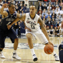 Feb 27, 2013; Storrs, CT, USA; Connecticut Huskies guard Shabazz Napier (13) drives the ball against Georgetown Hoyas guard Markel Starks (5) during the first half at Gampel Pavilion. (David Butler II-USA TODAY Sports)