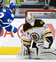 Boston Bruins goaltender Chad Johnson reacts as Toronto Maple Leafs center Nazem Kadri celebrates his game winning overtime goal in an NHL hockey game in Toronto on Thursday, April 3, 2014. (AP Photo/The Canadian Press, Frank Gunn)