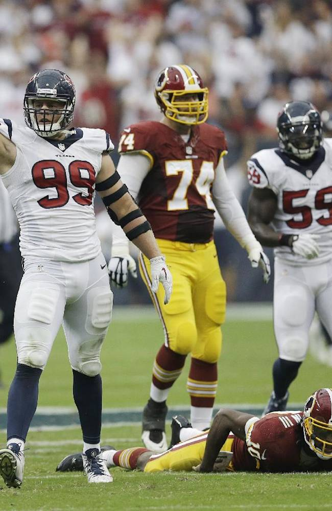 In this Sept. 7, 2014, file photo, Houston Texans' J.J. Watt celebrates after he sacked Washington Redskins' Robert Griffin III (10) during the second quarter of an NFL football game in Houston. The Houston Texans defensive end leads the NFL in quarterback hits, has a touchdown catch and has people wondering if he could be the first defensive player to win NFL MVP since Lawrence Taylor in 1986