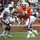 Auburn quarterback Nick Marshall (14) scrambles as defensive tackle Montravius Adams (1) watches during the first half of the A Day spring game for the NCAA college football team, Saturday, April 19, 2014 in Auburn, Ala The Associated Press