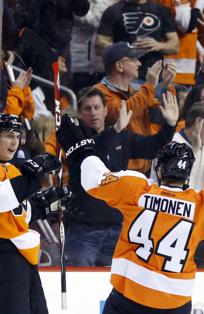 Philadelphia Flyers' Vincent Lecavalier, left, and Kimmo Timonen, of Finland, celebrate after Lecavalier's goal during the first period of an NHL hockey game against the Boston Bruins, Sunday, March 30, 2014, in Philadelphia