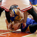 Golden State Warriors guard Stephen Curry (30) battles Chicago Bulls forward Carlos Boozer, standing, and Kirk Hinrich for a loose ball during the first half of an NBA basketball game, Wednesday, Feb. 26, 2014, in Chicago The Associated Press