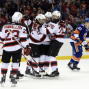 New Jersey Devils left wing Mike Cammalleri (23) skates in to celebrate right wing Damien Brunner's (12) goal with defenseman Adam Larsson (5) and defenseman Seth Helgeson (25) as New York Islanders center Anders Lee (27) skates off in the first period o