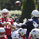 New England Patriots quarterback Tom Brady throws a pass to defensive tackle Vince Wilfork (75) during an NFL football practice in Foxborough, Mass., Wednesday, Aug. 20, 2014 The Associated Press