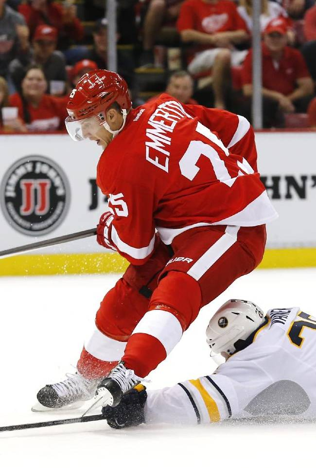 Detroit Red Wings center Cory Emmerton (25) is brought down by Buffalo Sabres left wing Thomas Vanek (26) in the second period of an NHL hockey game in Detroit, Wednesday, Oct. 2, 2013. Emmerton was awarded a penalty shot on the tripping penalty