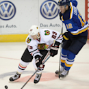 Chicago Blackhawks' Kris Versteeg (23) skates around St. Louis Blues' Jori Lehtera (12), of Finland, during the second period of an NHL hockey game, Saturday, Oct. 25, 2014, in St. Louis. The Blues won 3-2 The Associated Press