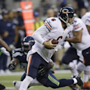 Seattle Seahawks' O'Brien Schofield, left, brings down Chicago Bears quarterback Jay Cutler for a sack in the first half of a preseason NFL football game, Friday, Aug. 22, 2014, in Seattle The Associated Press