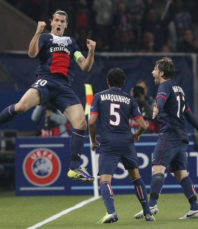 PSG's Zlatan Ibrahimovic, jumps in the air as he celebrates scoring a goal during the Champions League group C soccer match between Paris Saint Germain and Benfica, at the Parc des Princes stadium, in Paris, Wednesday, Oct. 2, 2013