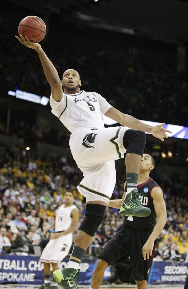Michigan State's Adreian Payne (5) shoots a layup in the first half during the third-round game of the NCAA men's college basketball tournament against Harvard in Spokane, Wash., Saturday, March 22, 2014