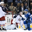 Toronto Maple Leafs' Daniel Winnik, right, celebrates his goal in front of Columbus Blue Jackets' Matt Calvert, left, and goaltender Sergei Bobrovsky during the first period of an NHL hockey game Friday, Jan. 9, 2015, in Toronto The Associated Press