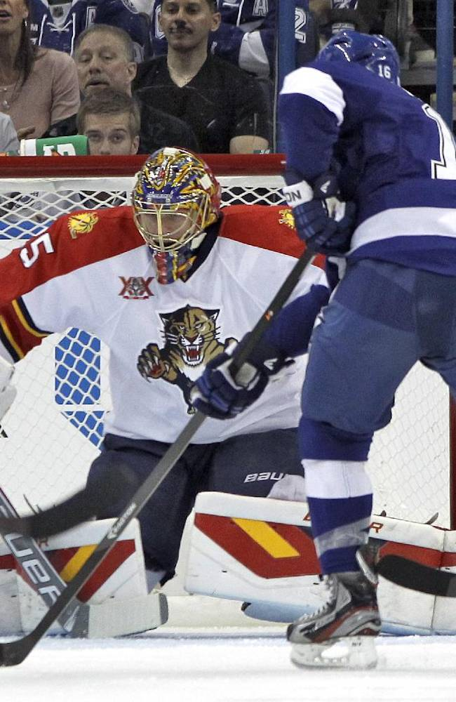 Florida Panthers goalie Jacob Markstrom (25), of Sweden, stops a shot by Tampa Bay Lightning right wing Teddy Purcell (16) during the first period of an NHL hockey game Thursday, Oct. 10, 2013, in Tampa, Fla