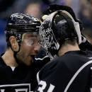 Los Angeles Kings defenseman Alec Martinez, left, celebrates their win against the San Jose Sharks with Los Angeles Kings goalie Martin Jones after an NHL hockey game in Los Angeles, Thursday, Dec. 19, 2013. (AP Photo/Chris Carlson)