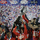 Chile's players hold up the trophy after the Copa America final soccer match against Argentina at the National Stadium in Santiago, Chile, Saturday, July 4, 2015. Bravo made a save and striker Alexis Sanchez converted the winning penalty as host Chile defeated Argentina 4-1 in a shootout after a 0-0 draw in the Copa America final on Saturday, finally winning its first major title.(AP Photo/Natacha Pisarenko)