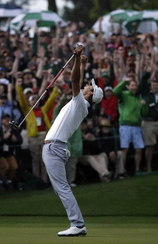 Adam Scott, of Australia, celebrates after making a birdie putt on the second playoff hole to win the Masters golf tournament Sunday, April 14, 2013, in Augusta, Ga