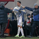 Assistants cover Dinamo Moscow's Kevin Kuranyi, center, as he leaves the field during the Europa League Group E soccer match between Dynamo Moscow and Panathinaikos at the Arena Khimki stadium in Moscow, Russia, Thursday, Nov. 27, 2014 The Associated Pres