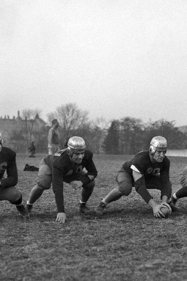 In this 1936 file photo, the Varsity line of the Fordham University football team is shown. From left, John Druze, Al Babartsky, Vince Lombardi, Alex Wojciechowicz, Nat Pierce, Ed Franco and Leo Paquin. Vince Lombardi and rest of the seven blocks of granite might have a hard time recognizing football the way it's being played at Fordham these days, fast and furious. They would, however, love the results. The Rams are 7-0 for the first time since 1930