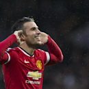 Manchester United's Robin van Persie celebrates after scoring, during the English Premier League soccer match between Manchester United and Liverpool at Old Trafford Stadium, Manchester, England, Sunday Dec. 14, 2014