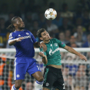 Chelsea's Didier Drogba, left, and Schalke's Kaan Ayhan go for a header during the Champions League group G soccer match between Chelsea and Schalke 04 at Stamford Bridge stadium in London, Wednesday, Sept. 17, 2014