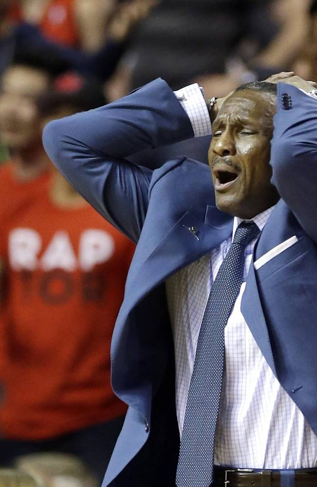 Toronto Raptors head coach Dwane Casey reacts after a call during the second half of an NBA basketball game against the Detroit Pistons in Auburn Hills, Mich., Sunday, April 13, 2014. The Raptors won 116-107