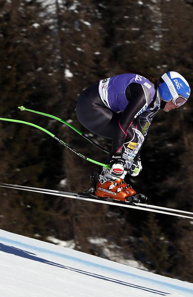 Stacey Cook, of the US, is airborne during an alpine ski, World Cup women's downhill training, in Cortina d'Ampezzo, Italy, Wednesday, Jan. 22 , 2014