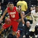 New Mexico guard Kendall Williams, left, picks up a loose ball as Colorado State guard Jon Octeus covers in the second half of New Mexico's 91-82 victory in an NCAA basketball game in Fort Collins, Colo., on Saturday, Feb. 23, 2013. (AP Photo/David Zalubowski)