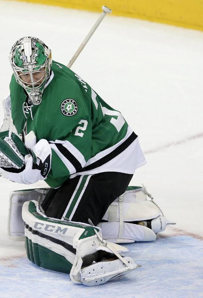 Dallas Stars' Kari Lehtonen looks back to see a score by Colorado Avalanche's Paul Stastny in overtime of an NHL hockey game, Friday, Nov. 1, 2013, in Dallas. The Avalanche won 3-2