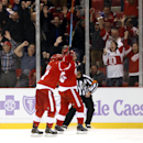 Detroit Red Wings defenseman Niklas Kronwall, front right, of Sweden, celebrates his goal against the Pittsburgh Penguins with teammate Gustav Nyquist (14), also of Sweden, in the third period of an NHL hockey game in Detroit, Thursday, Oct. 23, 2014 The