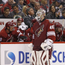 Arizona Coyotes' Devan Dubnyk (40) skates off the ice after being pulled from the game during the second period of an NHL hockey game against the Boston Bruins Saturday, Dec. 6, 2014, in Glendale, Ariz The Associated Press