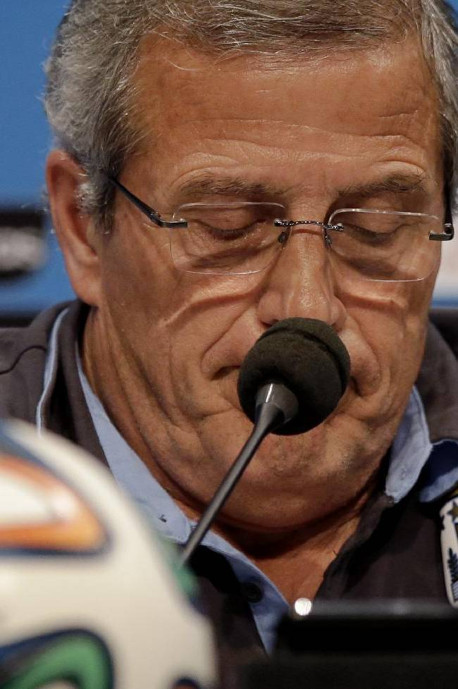 Uruguay's head coach Oscar Tabarez looks down as he makes a statement during a press conference the day before the round of 16 World Cup soccer match between Colombia and Uruguay at the Maracana Stadium in Rio de Janeiro, Brazil, Friday, June 27, 2014.  FIFA banned Uruguay striker Luis Suarez from all football activities for four months on Thursday for biting an opponent at the World Cup, a punishment that rules him out of the rest of the tournament and the start of the upcoming Premier League season