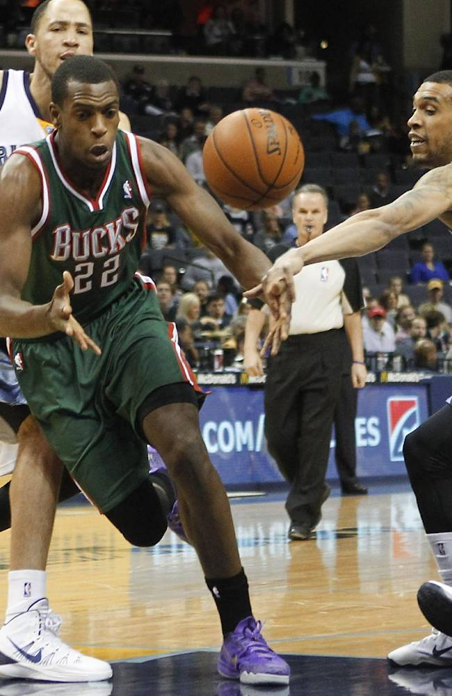 Memphis Grizzlies forward Courtney Lee, right, and forward Tayshaun Prince, back left, strip the ball from Milwaukee Bucks forward Khris Middleton (22) in the first half of an NBA basketball game on Saturday, Feb. 1, 2014, in Memphis, Tenn