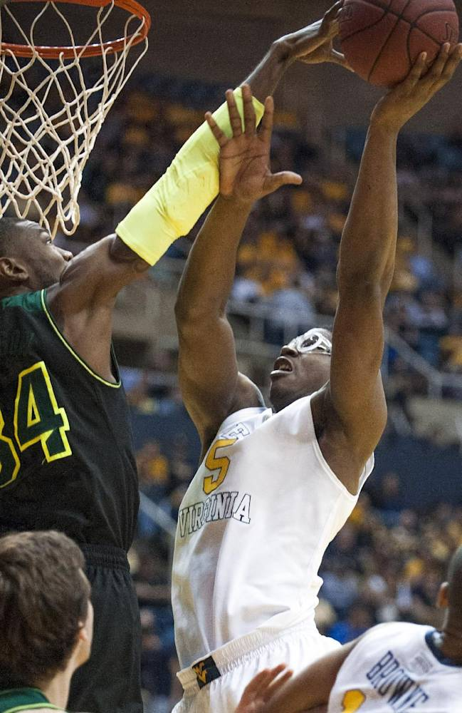 Baylor's Cory Jefferson, left, blocks West Virginia's Devin Williams during the second half of an NCAA college basketball game Saturday, Feb. 22, 2014, in Morgantown, W.Va. Baylor won 88-75
