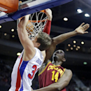 Detroit Pistons forward Jonas Jerebko (33), of Sweden, gets past Cleveland Cavaliers center Henry Sims (14) to dunk the ball during the second half of an NBA basketball game Wednesday, Feb. 12, 2014, in Auburn Hills, Mich. The Cavaliers won 93-89 The Asso