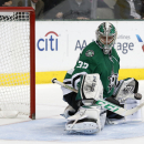 Dallas Stars goalie Kari Lehtonen (32), of FInland, makes a save during the second period of an NHL hockey game against the Carolina Hurricanes, Thursday, Feb. 27, 2014, in Dallas The Associated Press
