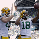 Green Bay Packers' Randall Cobb (18) celebrates his touchdown catch with teammate Jordy Nelson during the first half of the NFL football NFC Championship game against the Seattle Seahawks Sunday, Jan. 18, 2015, in Seattle The Associated Press