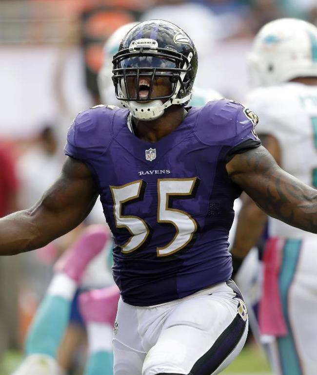 In this Oct. 6, 2013, file photo, Baltimore Ravens outside linebacker Terrell Suggs celebrates after sacking Miami Dolphins quarterback Ryan Tannehill during the second half of an NFL football game in Miami Gardens, Fla.  Suggs is going after Aaron Rodgers and a place in the Ravens record book this Sunday. Suggs is poised to become the first player in franchise history to have a sack in six straight games