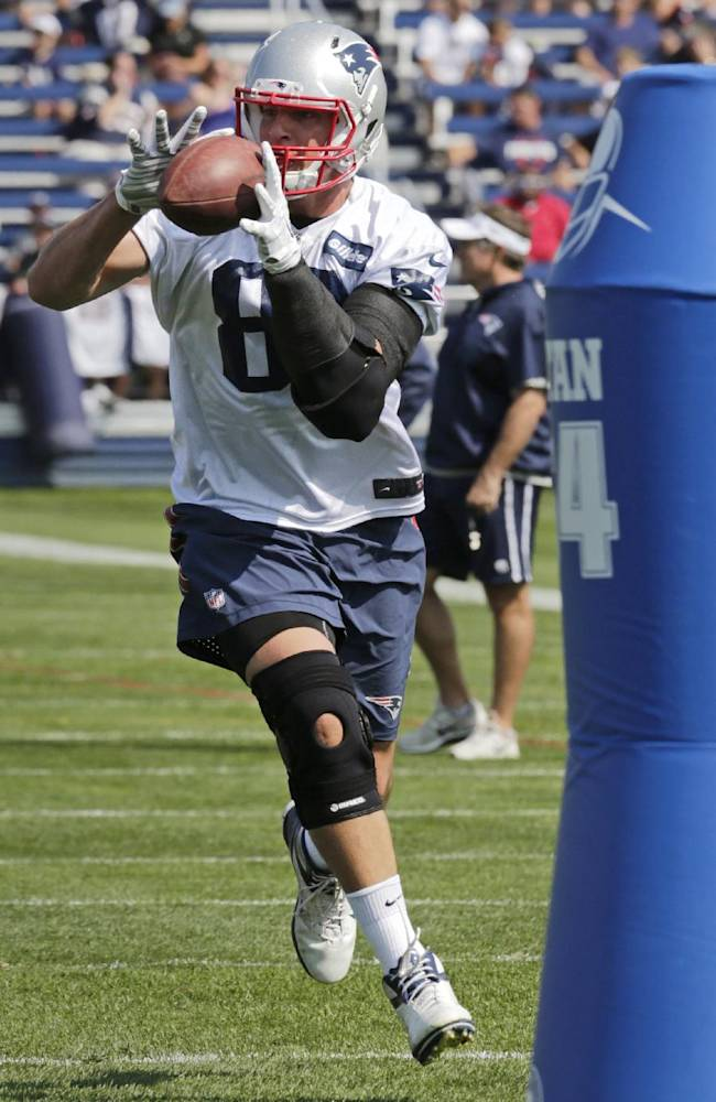 New England Patriots tight end Rob Gronkowski catches a pass during an NFL football training camp in Foxborough, Mass., Friday, July 25, 2014. (AP Photo)