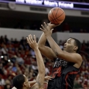North Carolina State's T.J. Warren (24) shoots over Clemson's K.J. McDaniels (32) during the first half of an NCAA college basketball game in Raleigh, N.C., Sunday, Jan. 20, 2013. (AP Photo/Gerry Broome)