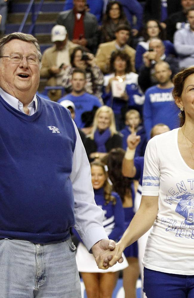 Actress Ashley Judd, right, leads the crowd in singing