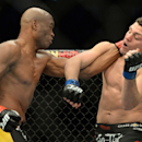 Jan 31, 2015; Las Vegas, NV, USA; Anderson Silva (red gloves) and Nick Diaz (blue gloves) fight during their middleweight bout during UFC 183 at the MGM Grand Garden Arena. (Jayne Kamin-Oncea-USA TODAY Sports)