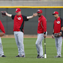 Cincinnati Reds' Jay Bruce signals safe on a play as Chris Heisey, from left, instructor Eric Davis, Billy Hamilton, and Roger Bernardina look on from the outfield during spring training baseball practice in Goodyear, Ariz., Tuesday, Feb. 25, 2014 The Ass