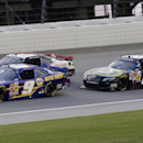 Chase Elliott (9) drives past Ty Dillon (3) and Erik Jones (20) during the NASCAR Nationwide series auto race at Chicagoland Speedway in Joliet, Ill., Saturday, July 19, 2014. (AP Photo/Nam Y. Huh)