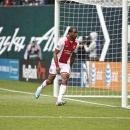 Portland Timbers forward Frederic Piquionne (10) scores the first goal in the first half against Colorado Rapids goalkeeper Clint Irwin (31) in an MLS soccer match, Sunday, June 23, 2013, at Jeld-Wen Field in Portland, Ore. (AP Photo/The Oregonian, Thomas Boyd)