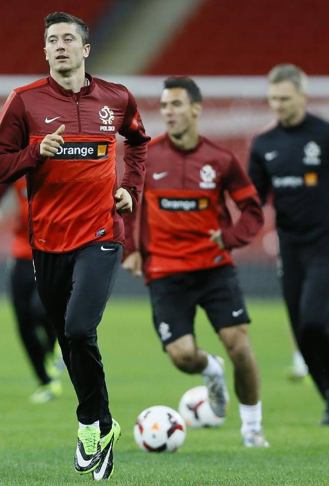 Poland's Robert Lewandowski runs during a training session at Wembley Stadium in London, Monday, Oct. 14, 2013. England will play Poland in a World Cup Group H qualification match at Wembley stadium in London on Tuesday