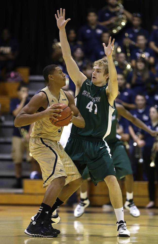 Florida International forward Jerome Frink, left, looks for an open teammate past Stetson guard Brian Pegg (41) during the first half of an NCAA college basketball game, Monday, Nov. 18, 2013 in Miami