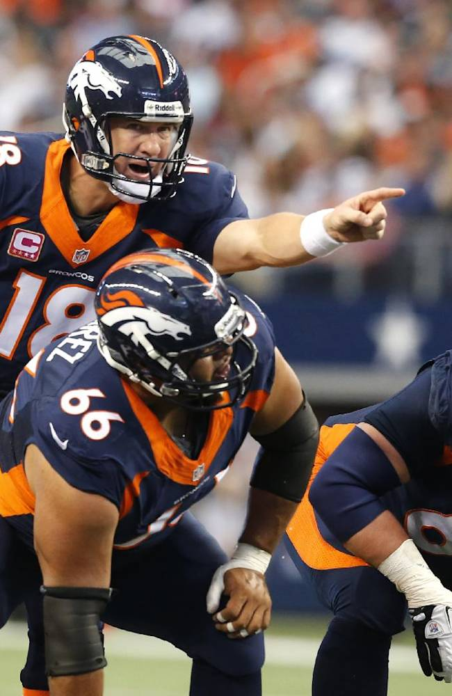 In this Oct. 6, 2013, photo, Denver Broncos quarterback Peyton Manning (18), center Manny Ramirez (66) and guard Zane Beadles (68) get ready for a play during an NFL football game against the Dallas Cowboys in Arlington, Texas. The man in the middle of Denver's offensive line, the one that's allowed the fewest sacks in the league, is the center who had never started a game at the position before this season